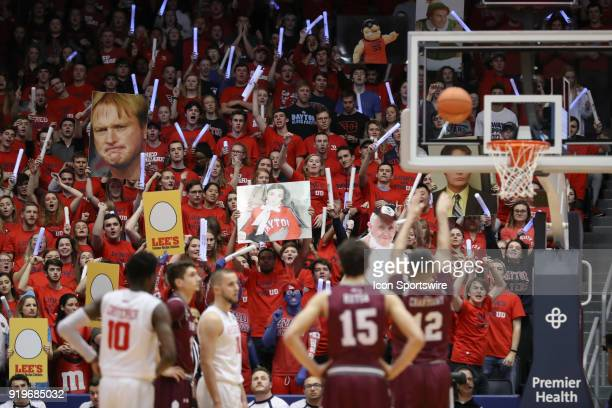 A large printed head of Jon Gruden is uses to distract Fordham Rams guard Joseph Chartouny during his free throw attempt in a game between the Dayton...