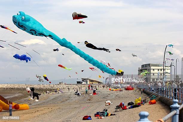 Large professional kites being flown on Morecambe beach in Lancashire, UK.
