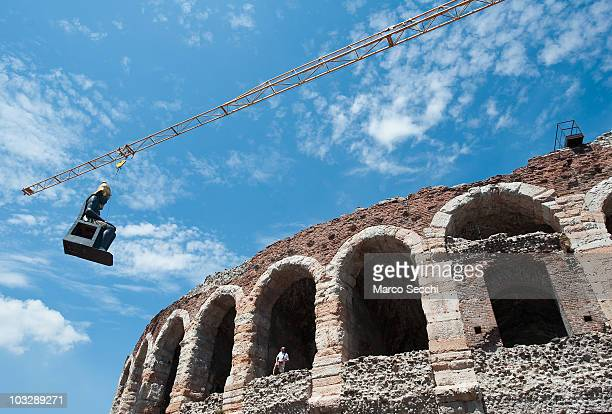 A large prop of an Egyptian statue is brought inside the Arena by crane ahead of the evenings performance of 'Aida' on August 8 2010 in Verona Italy...