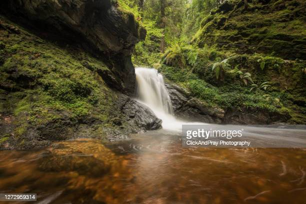 large pucks glen waterfall - motion stock pictures, royalty-free photos & images