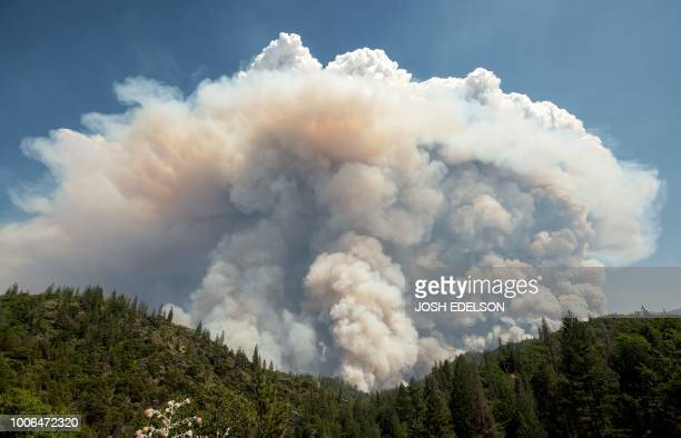 A large pyrocumulus cloud explodes outward during the Carr fire near Redding California on July 27 2018 Two firefighters have died and more than 100...