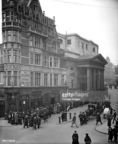 Large queue outside the Lyceum Theatre, London, 1909. Henry Irving and Ellen Terry both performed there. Built in 1834, only the facade of the...