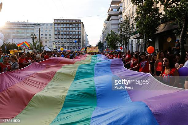 STREET ATHENS ATTICA GREECE A large rainbow flag is carried through the streets of Athens at the 10th Athens Gay Pride Parade 2015Several thousand...