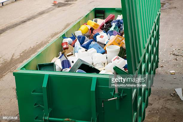 large recycling bin full of discarded plastic containers - garbage bin stock pictures, royalty-free photos & images