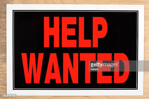 Large red and black help wanted sign