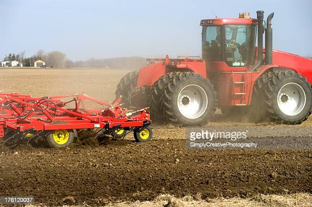 large red farm tractor - tiller stock photos and pictures