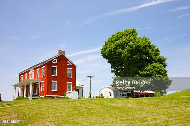 Large red house & tree on hilltop, Upstate NY