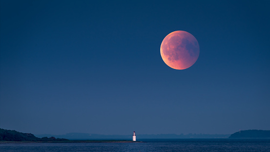 Large red moon rising - gettyimageskorea