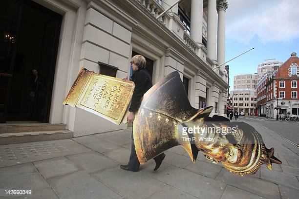 A large representation of an Olivier Award Statuette is delivered as part of the preperations for the Olivier Awards on Sunday at The Royal Opera...