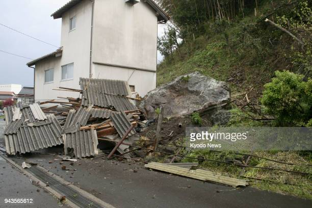 A large rock is seen fallen beside a residential house in Oda Shimane Prefecture after a magnitude 61 earthquake hit the western Japan prefecture on...
