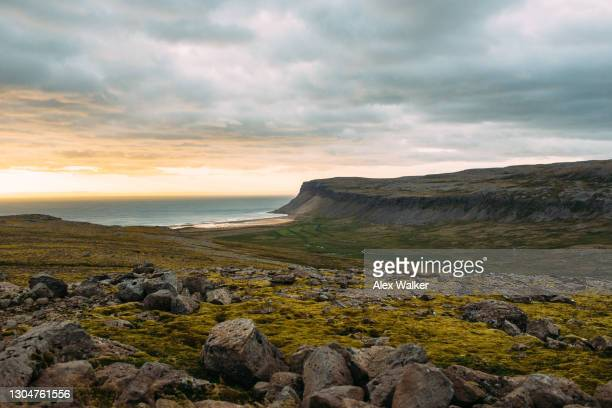 a large rock peninsula in dramatic landscape of the westfjords, iceland. - 浅い ストックフォトと画像
