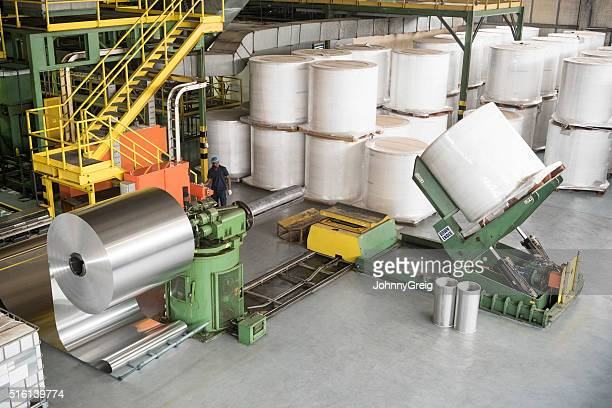 Large rolls of aluminium on machinery, high angle