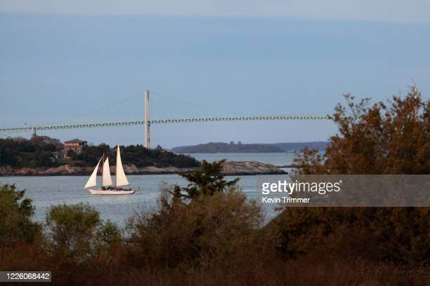 large sailboat in narragansett bay with newport bridge - rhode island stock pictures, royalty-free photos & images