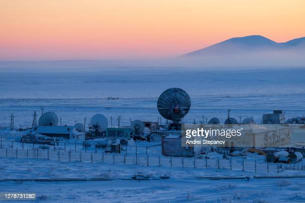 large satellite dishes in the snowy tundra in the arctic - russia stock pictures, royalty-free photos & images