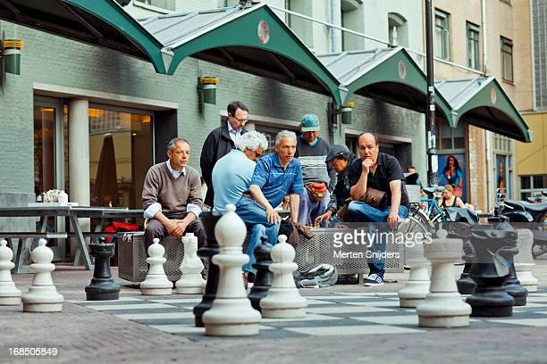large scale chess game in progress - merten snijders stock-fotos und bilder