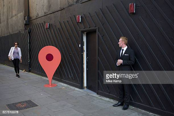 Large scale Google 'you are here' pin outside a PR event in London UK
