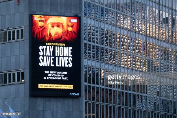 Large scale HM Government, and NHS advertising board advice to stay at home and help save lives during the third national coronavirus lockdown in...