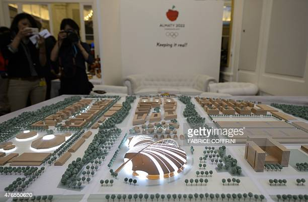 A large scale model of the Olympic Park project is displayed during a presentation of the Almaty 2022 candidate city bid before the International...