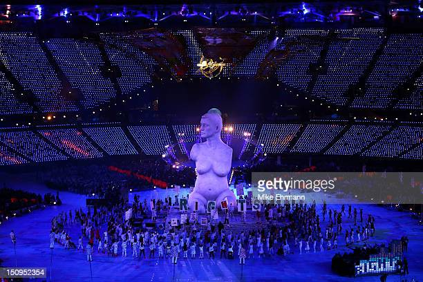 Large scale reproduction of Marc Quinn's celebrated sculpture 'Alison Lapper Pregnant' emerges during the Opening Ceremony of the London 2012...