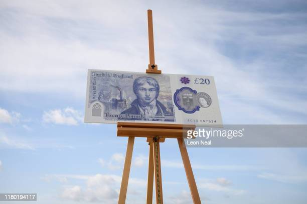 A large scale sample of the new twenty pound note is seen during the launch event for the new note design at the Turner Contemporary gallery on...