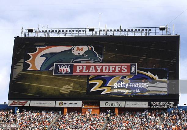 A large scoreboard shows a playoff logo as the Miami Dolphins host the Baltimore Ravens in an NFL Wildcard Playoff Game at Dolphins Stadium on...
