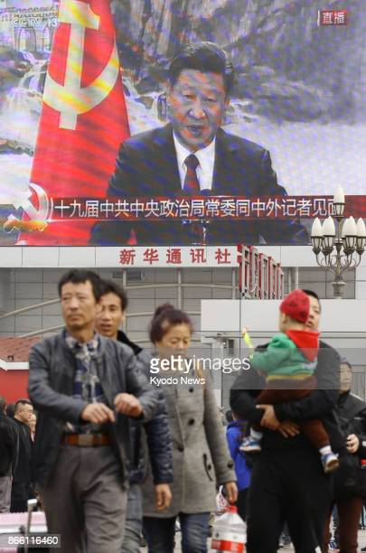 A large screen in Beijing shows President Xi Jinping speaking at a press conference on Oct 25 2017 China unveiled a new leadership team but without...