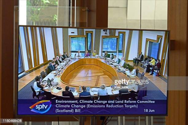 A large screen in the lobby of the Scottish Parliament relays proceedings as MSPs on the Environment Climate Change and Land Reform Committee discuss...