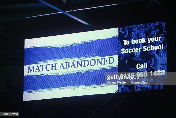 A large screen informing the fans that the game is called off at half time in the Sky Bet Championship match between Reading and Fulham at Madejski...