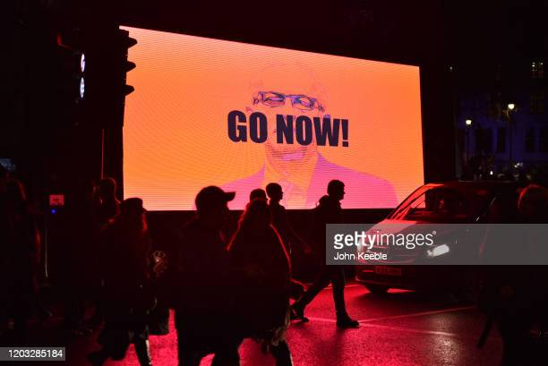 A large screen on the side of a bus shows Jeremy Corbyn with the words Go Now during the Leave Means Leave Brexit day celebration party outside the...