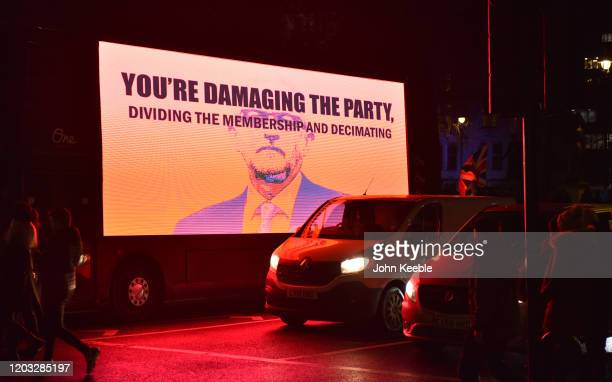 A large screen on the side of a bus shows Jeremy Corbyn with the words You're Damaging The Party during the Leave Means Leave Brexit day celebration...