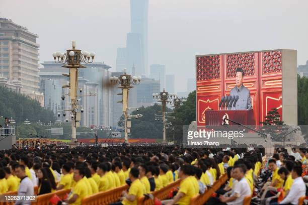 Large screen shows Chinese President Xi Jinping makes a speech during the celebration marking the 100th anniversary of the founding of the Chinese...