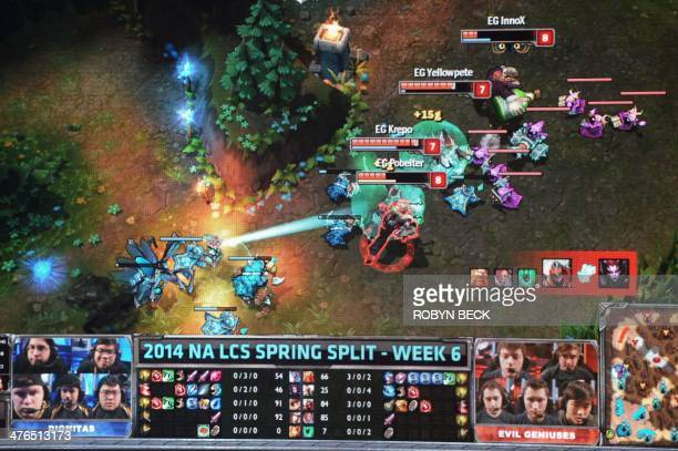 A large screen shows the action during a match between League of Legends professional teams 'Dignitas' and 'Evil Genius' during the League of Legends...