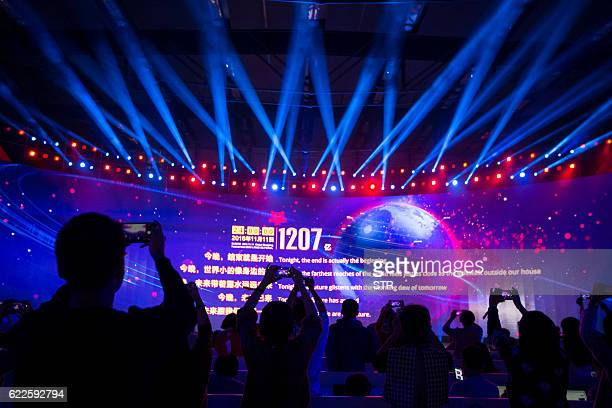 A large screen shows the final total gross merchandise volume a measure of sales after 24 hours of Singles Day sales at the Tmall 1111 Global...