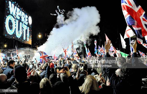 A large screen shows the words We're Out at 1100pm as Brexit celebration continues outside the Houses of Parliament at Parliament Square on January...