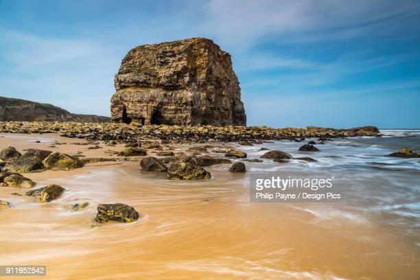 Large Sea Stack On Sandy Beach On The North East Coast Of England