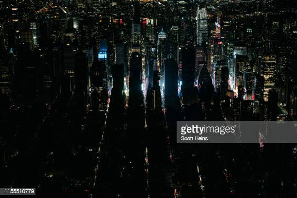 A large section of Manhattan's Upper West Side and Midtown neighborhoods are seen in darkness from above during a major power outage on July 13 2019...