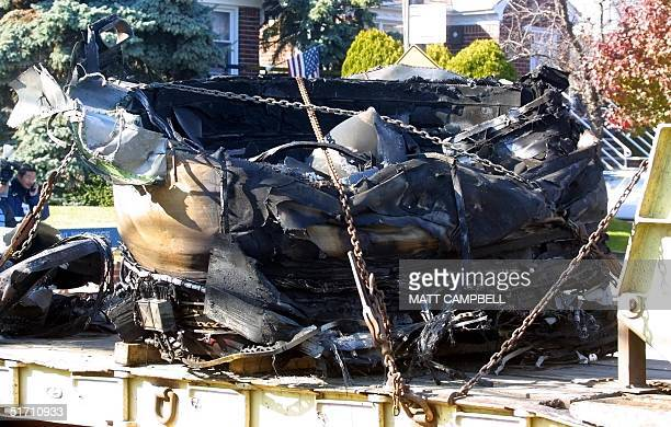 A large section of one of the engines from America Airlines Flight 587 sits on a truck 14 November 2001 in the Belle Harbor area of Queens NY The...