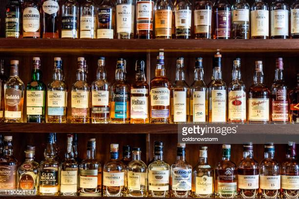 large selection of scottish malt whisky at the bar - alcohol drink stock pictures, royalty-free photos & images