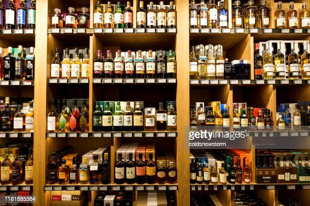 large selection of scottish malt whisky in boutique store - hard liquor stock pictures, royalty-free photos & images