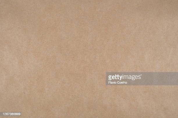 large sheet of brown paper texture background - carton stock pictures, royalty-free photos & images