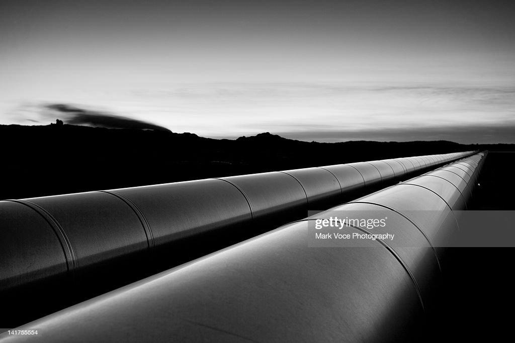 Large shiny metal pipes : Stock Photo