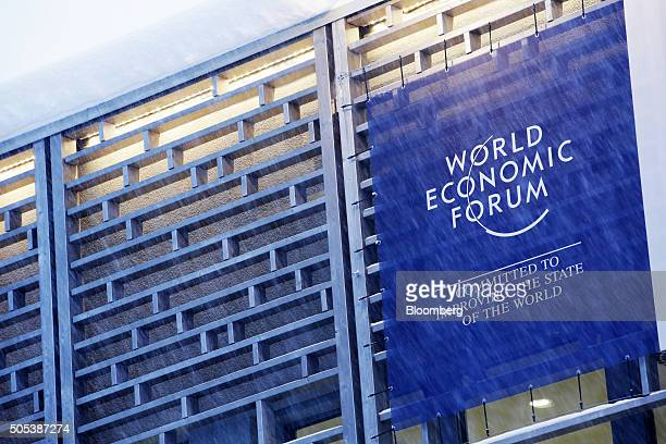 A large sign advertising the World Economic Forum hangs from a building near the conference centre in Davos Switzerland on Saturday Jan 16 2016 World...