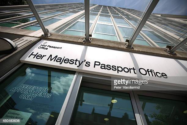 A large sign hangs over the entrance of the passport office on June 12 2014 in London England Home Secretary Theresa May has announced extra measures...