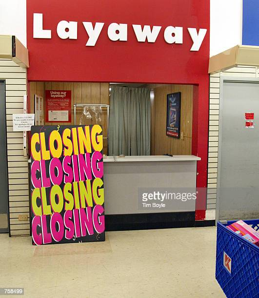A large sign that reads 'Closing Closing Closing Closing' sits at the Layaway department in a Kmart store March 25 2002 that is scheduled for closing...