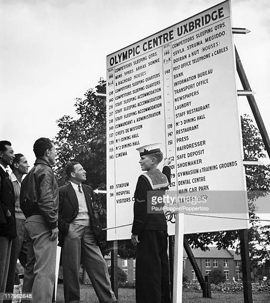 Large signboard helps athletes find their way around the Olympic village at Uxbridge, Middlesex, during the London Olympics, August 1948.