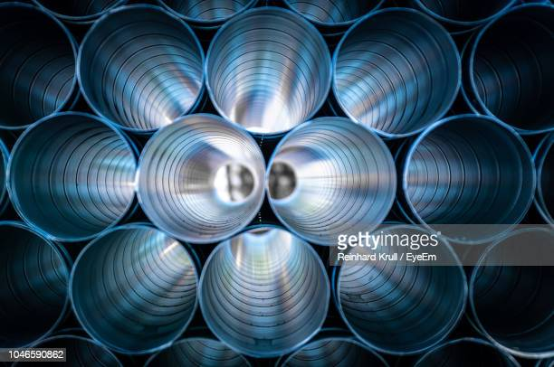 large silver pipes stacked at factory - stahl stock-fotos und bilder