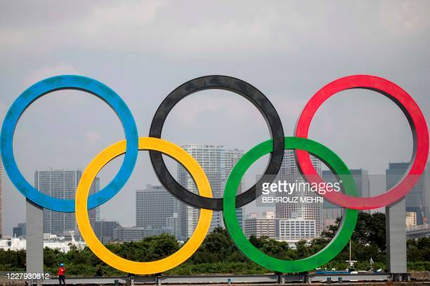 A large size Olympic rings symbol is seen at Tokyo Waterfront in the waters of Odaiba Marine Park on August 6 while being transferred back to the...