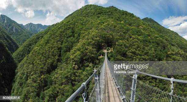 large size panoramic view of carasc suspension bridge, ticino, switzerland - ascona stock pictures, royalty-free photos & images