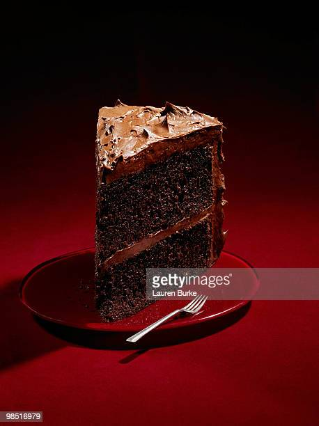 Large Slice Chocolate Cake on Red Background