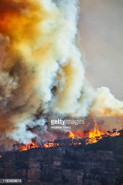 large smoke cloud from forest fires, bushfires on mountain, air pollution, climate change in australia - australia fires stock pictures, royalty-free photos & images
